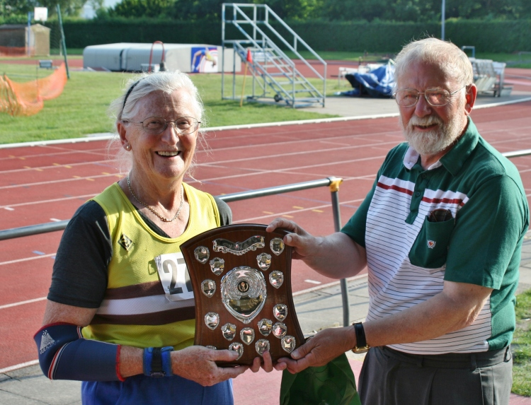 Rosemary Chrimes being presented with the Best Performance Trophy by Brian Owen at the MMAC T&F Championships 2008