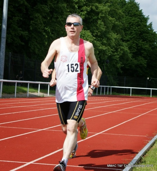 Martin Wilkinson, MMAC Treasurer, competing in the 5000m race at the MMAC T&F Championships 2013